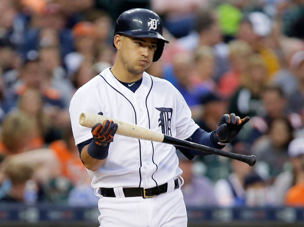 . Detroit Tigers\' Jose Iglesias reacts after swinging for a strike during the fifth inning of a baseball game against the Cleveland Indians Friday, June 12, 2015, in Detroit. Iglesias came up with a single during the at-bat. (AP Photo/Duane Burleson)