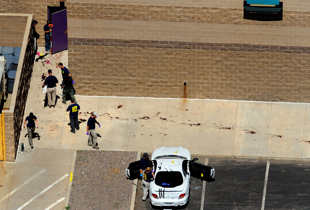 . A shooting at The Century 16 movie theater that left 12 people dead and over 35 people in the hospital with gunshot wounds.  The suspects car was found in the back of the theatre. ATF agents and police investigate the scene. Helen H. Richardson, The Denver Post
