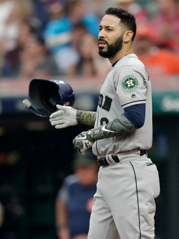 . Houston Astros\' Marwin Gonzalez throws his helmet after striking out in the first inning of a baseball game against the Cleveland Indians, Saturday, May 26, 2018, in Cleveland. (AP Photo/Tony Dejak)