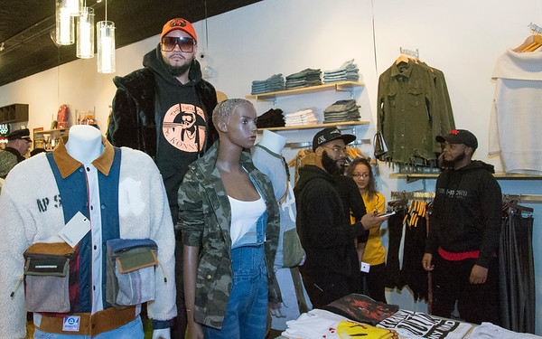 10/17/19 Wesley Bunnell | StaffrrNew Britain's newest clothing store, Un Known, opened on Main St with a ribbon cutting on Thursday afternoon. DJ Stevey Newnez poses along with mannequins at the front of the store.