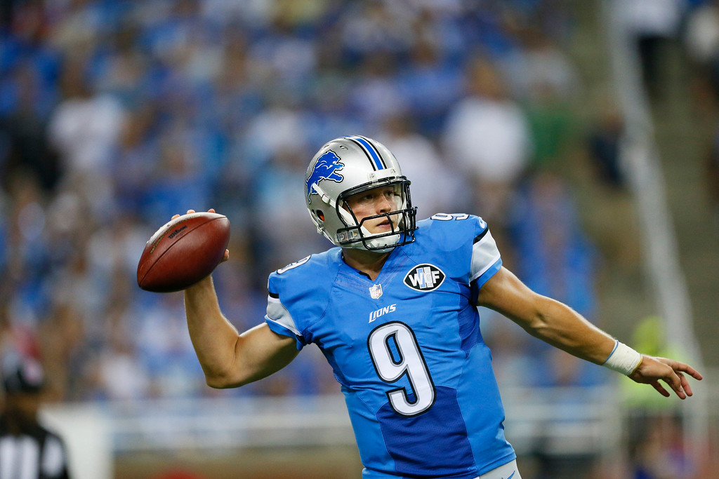 . Detroit Lions quarterback Matthew Stafford looks downfield during the first quarter of an NFL football game against the New York Giants in Detroit, Monday, Sept. 8, 2014. (AP Photo/Rick Osentoski)
