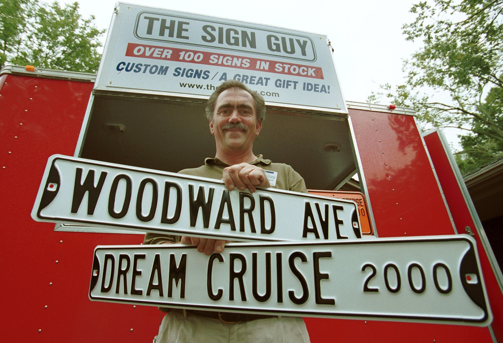 . Bill Loizon, The Sign Guy, will be hawking these custom street signs out of his red trailer at the Dream Cruise this weekend.