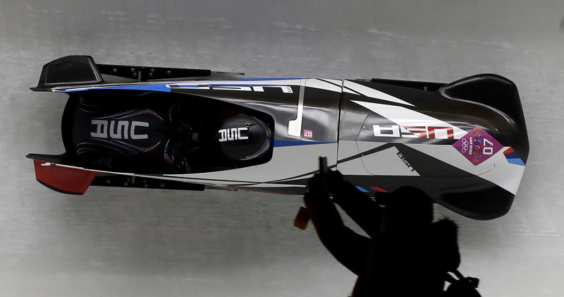 . The team from the United States USA-3, piloted by Jazmine Fenlator with brakeman Lolo Jones, take a curve during the women\'s bobsled competition at the 2014 Winter Olympics, Wednesday, Feb. 19, 2014, in Krasnaya Polyana, Russia. (AP Photo/Dita Alangkara)