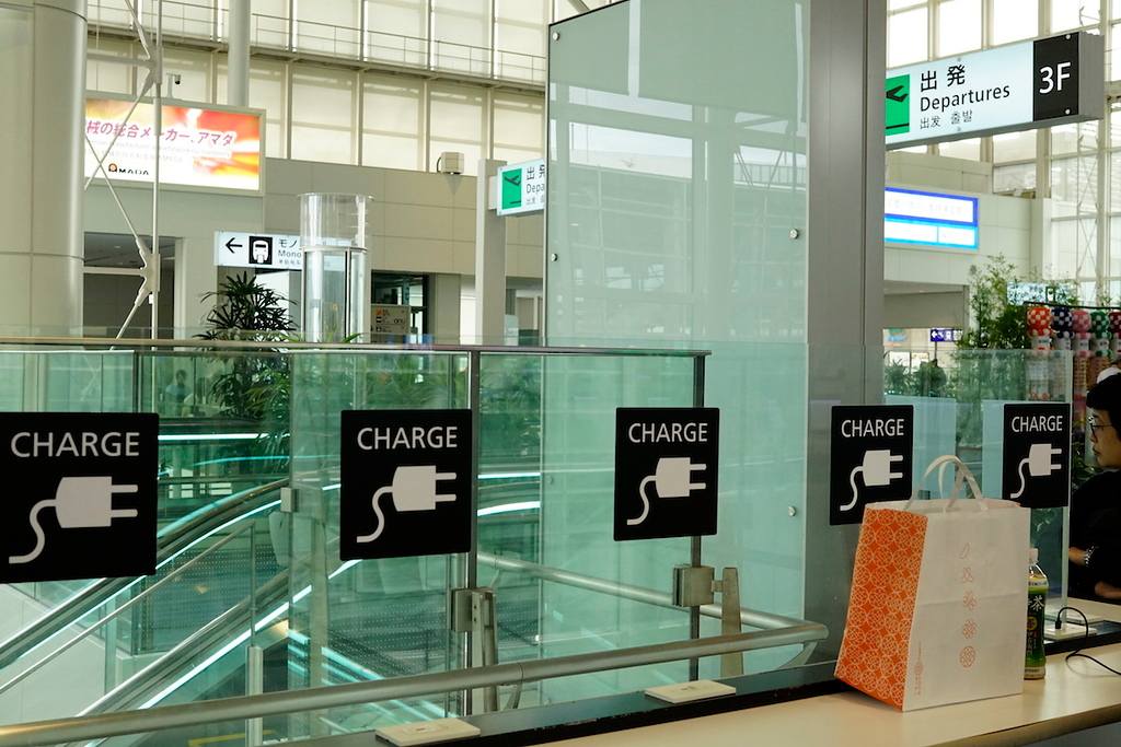 Charging stands near the information desk in the departures hall.