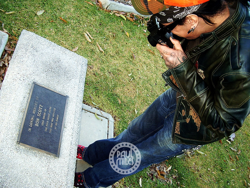 Avid photographer Nikki Sixx shooting the memorial seat of the late AC/DC singer Bon Scott on a visit to Fremantle Cemetery during Motley Crue's 2005 Australian Tour.