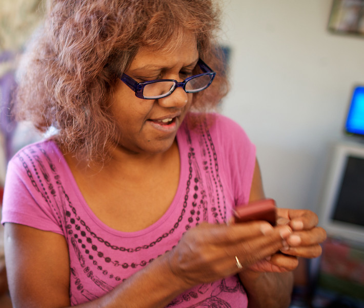 Indigenous Australian Woman using a Mobile Phone