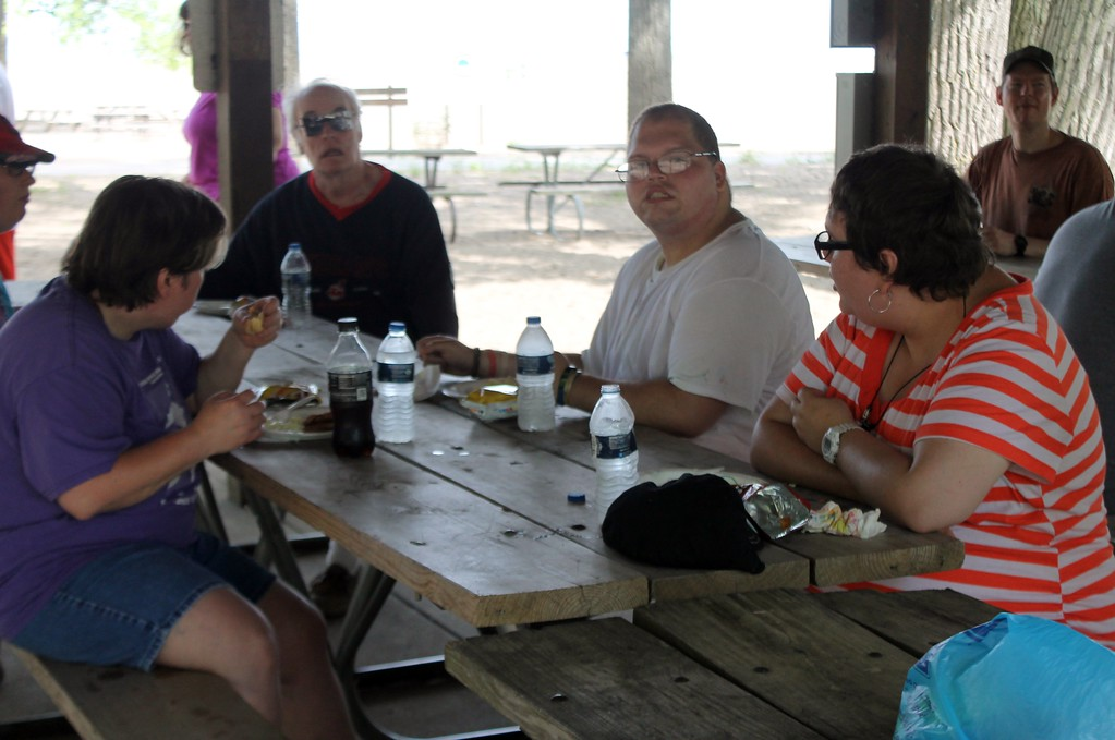 . Kristi Garabrandt � The News-Herald <br> Participants in Lake County Board of DD/Deepwood Recreation Service Program enjoy a cook-out after completing a beach clean up project at Mentor Headlands Beach.