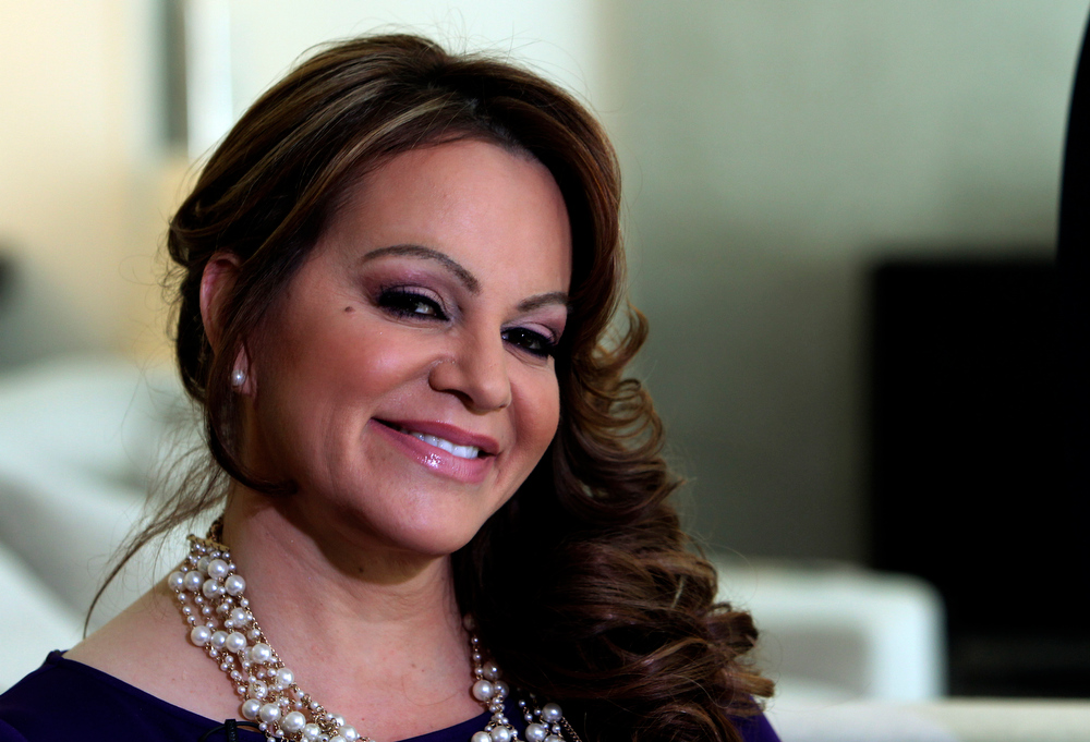 . In this picture taken March 8, 2012, Mexican-American singer and reality TV star Jenni Rivera poses during an interview in Los Angeles. The wreckage of a small plane believed to be carrying Mexican-American music superstar Jenni Rivera was found in northern Mexico on Sunday, Dec. 9, 2012, and there are no apparent survivors, authorities said.  (AP Photo/Reed Saxon)