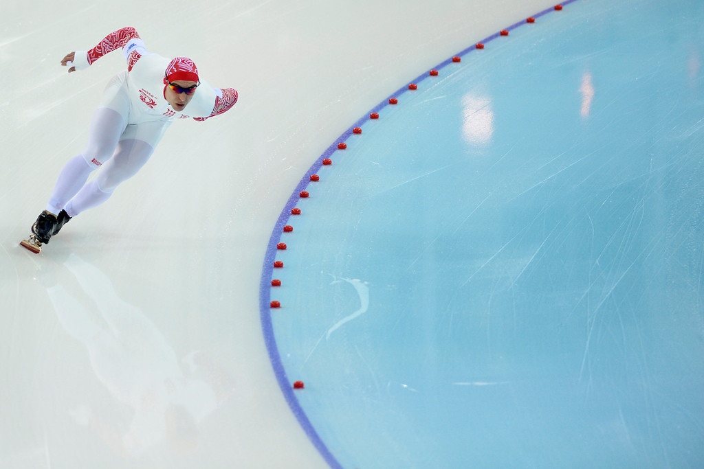 . Russia\'s Dmitry Lobkov makes his first turn during the speed skating men\'s 500-meter at Adler Arena. Sochi 2014 Winter Olympics on Monday, February 10, 2014. (Photo by AAron Ontiveroz/The Denver Post)