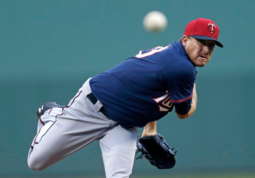 . Minnesota Twins starting pitcher Kevin Correia pitches in the first inning of an exhibition baseball game against the Boston Red Sox. (AP Photo/Gerald Herbert)