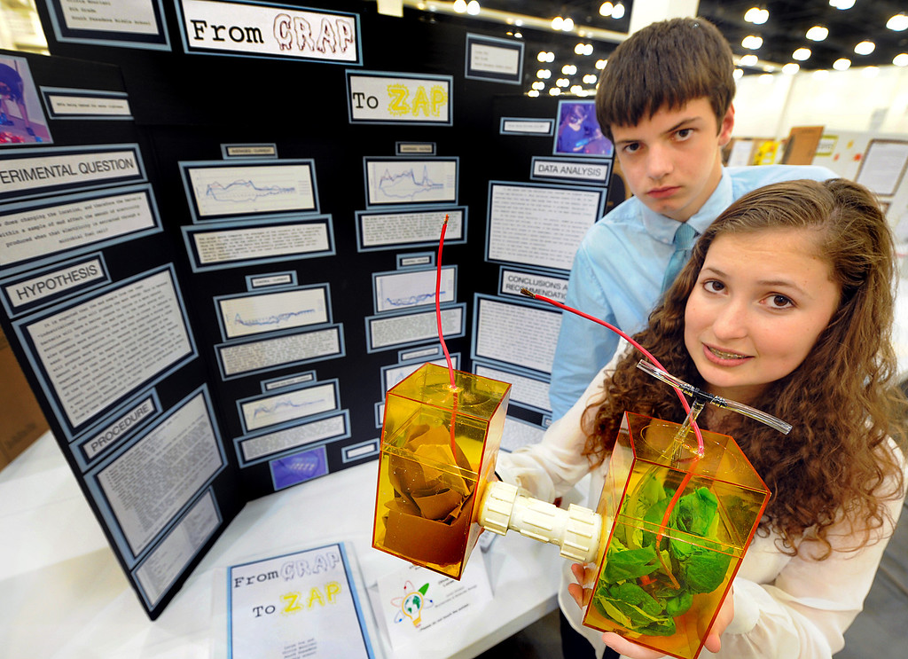 ". Lucus Fox, and Olivia Nouriani, right, with their experiment, "" From Crap To Zap-Using The Microbial Fuel Cell To Turn Waste Into Energy\"", demonstrating their science project, at the 63rd annual Los Angeles County Science Fair at Pasadena Convention Center Friday, March 22, 2013. Organizers scrambled to raise enough funds this year, and almost had to do without tables and chairs until a $25,000 donation by Southern California Edison at the last minute. (SGVN/Photo by Walt Mancini/SXCity)"