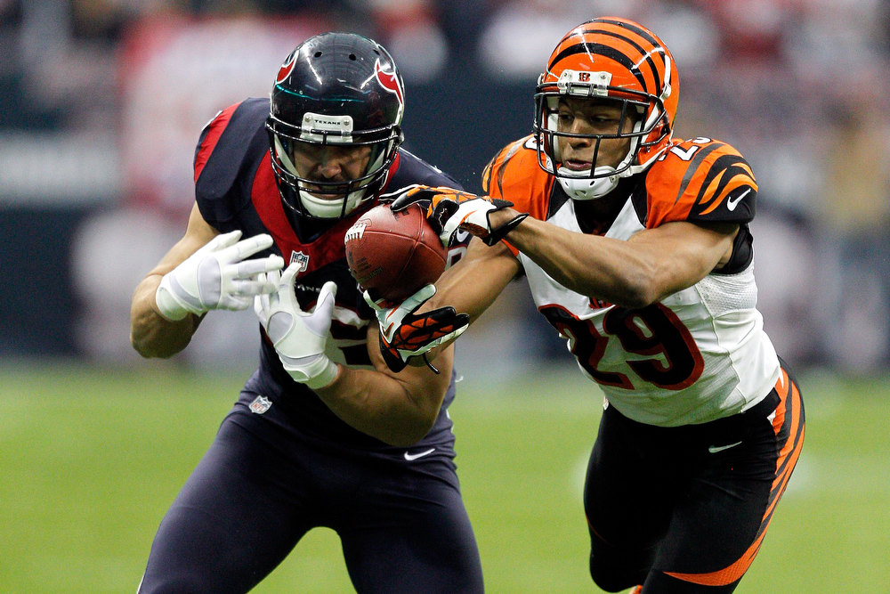 . Leon Hall #29 of the Cincinnati Bengals intercepts a pass and returns it 21-yards for a touchdown in the second quarter against James Casey #86 of the Houston Texans during their AFC Wild Card Playoff Game at Reliant Stadium on January 5, 2013 in Houston, Texas.  (Photo by Bob Levey/Getty Images)