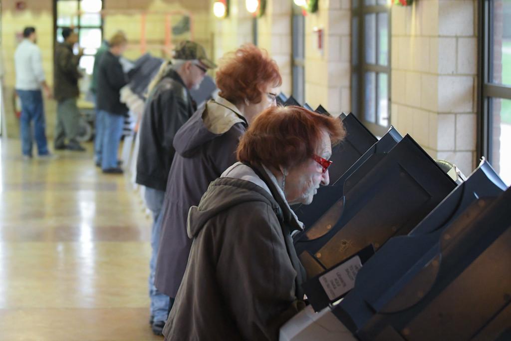 . Eric Bonzar�The Morning Journal<br> Voters cast their ballots at Black River Landing\'s Transportation Center, in Lorain, Nov. 7, 2017.