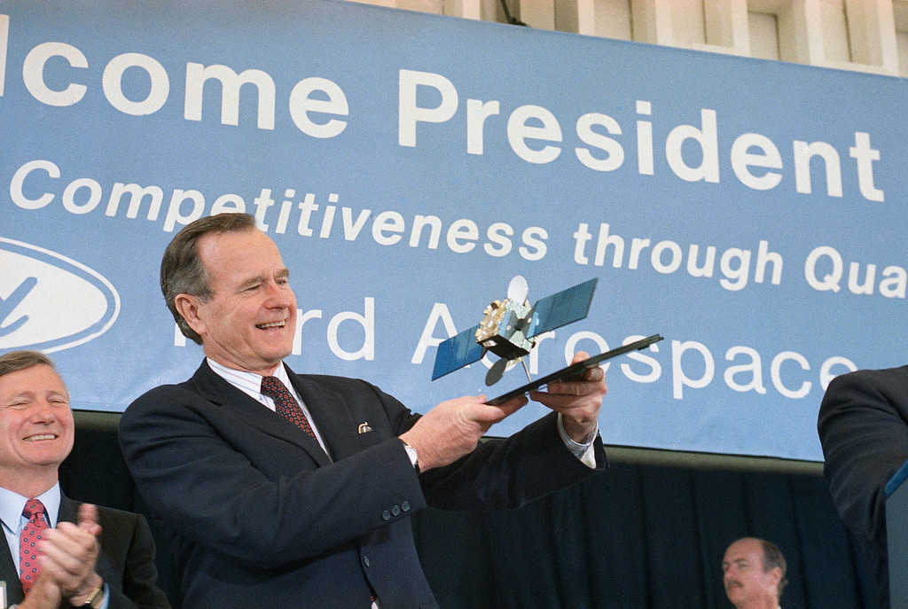 . President George Bush holds up a Super Bird B satellite model during his tour of Ford Aerospace Systems Division in Palo Alto, Calif., April 25, 1989. The model was presented him by Donald Rassier, Ford Aerospace president. Super Bird B program is a $200 million communications project for a Japanese firm. (AP Photo/Marcy Nighswander)