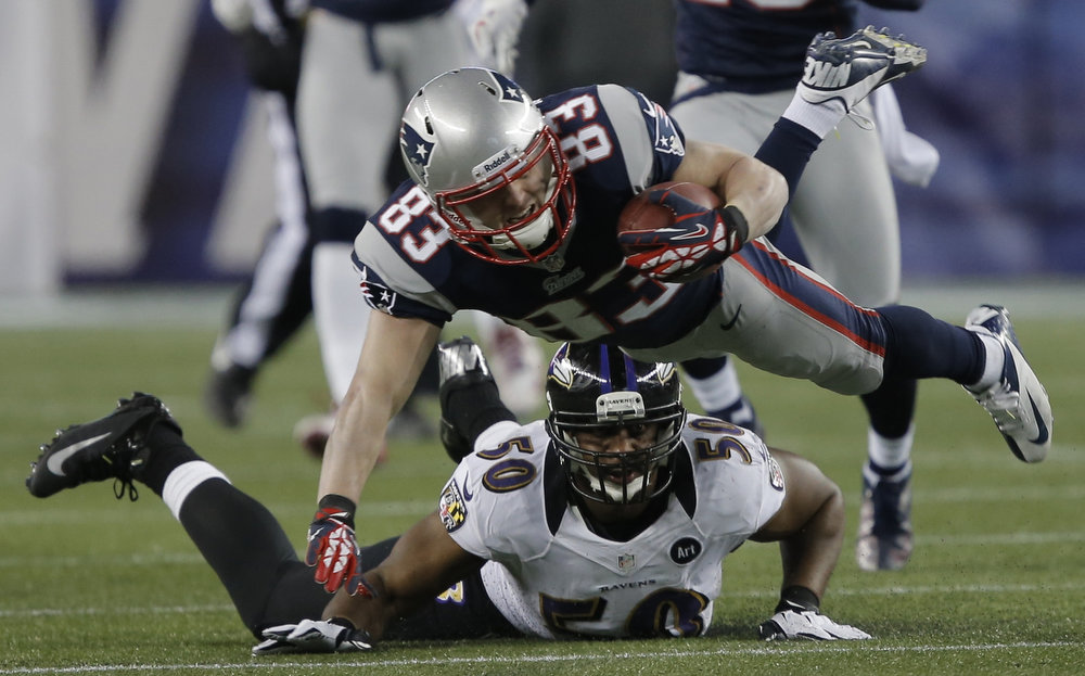 . New England Patriots wide receiver Wes Welker (83) is brought down by Baltimore Ravens outside linebacker Albert McClellan during the first quarter in the NFL AFC Championship football game in Foxborough, Massachusetts January 20, 2013. REUTERS/Ray Stubblebine