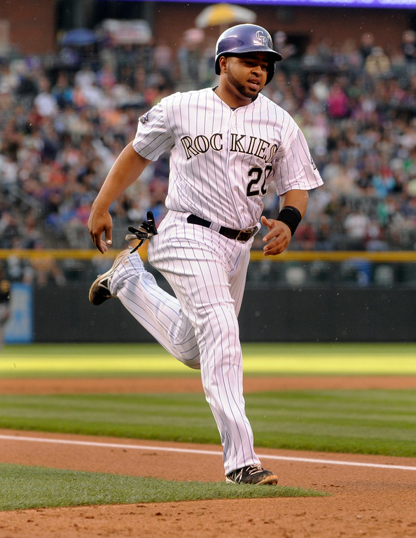 . DENVER, CO. - AUGUST 09: Colorado baserunner Wilin Rosario scored from second on a single by Todd Helton in the first inning. The Colorado Rockies hosted the Pittsburgh Pirates Friday night, August 9, 2013. Photo By Karl Gehring/The Denver Post