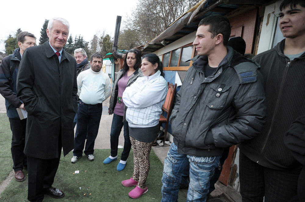 . Council of Europe Secretary General Thorbjoern Jagland (2ndL) speaks with people of the Roma community as he visits a camp as part of the International Roma Day on April 8, 2013 in Strasbourg, eastern France.   FREDERICK FLORIN/AFP/Getty Images