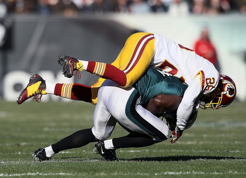 . Josh Wilson #26 of the Washington Redskins tackles Jason Avant #81 of the Philadelphia Eagles during the first quarter at Lincoln Financial Field on December 23, 2012 in Philadelphia, Pennsylvania.  (Photo by Alex Trautwig/Getty Images)