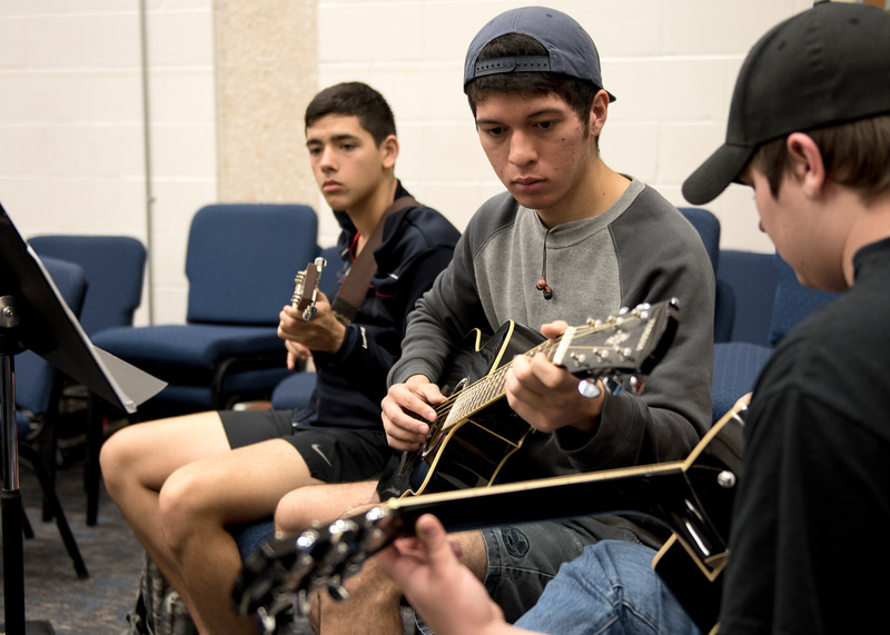 Students Francisco Derbosque(left) Mark Salloum and Drake Conggood(right) work together to prefect a peice.
