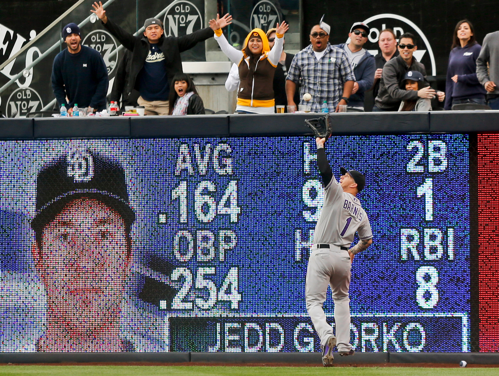 . Colorado Rockies right fielder Brandon Barnes makes the running catch at the wall on a drive by San Diego Padres\' Jedd Gyorko with a man on base and no outs during the ninth inning of the Rockies\' 3-1 victory in a baseball game Thursday, April 17, 2014, in San Diego. (AP Photo/Lenny Ignelzi)