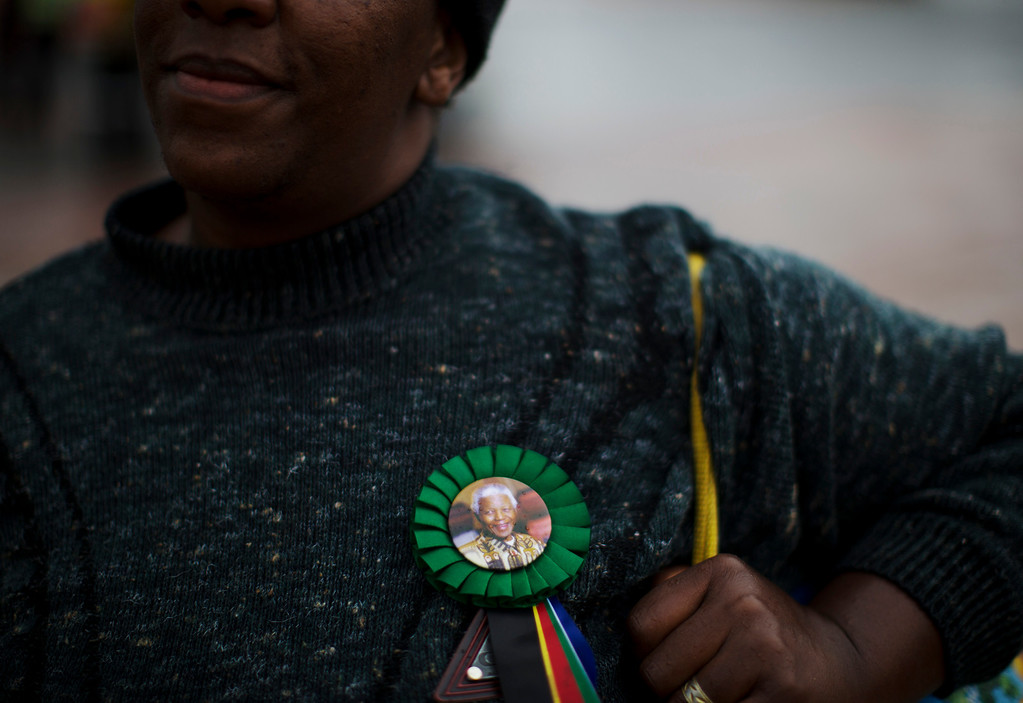 . A mourner arrives for the memorial service for former South African president Nelson Mandela at the FNB Stadium in Soweto near Johannesburg, Tuesday, Dec. 10, 2013. (AP Photo/)