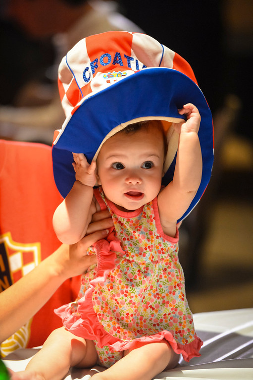 . Michelle Tomas, 9 months, shows her colors as she joined her parents to root on the Croatian soccer team as they took on Brazil.    Croatian fans gathered at St. Anthony Croatian Catholic Church in Los Angeles for the match which was the first one of the world cup.   ( Photo by David Crane/Los Angeles Daily News )
