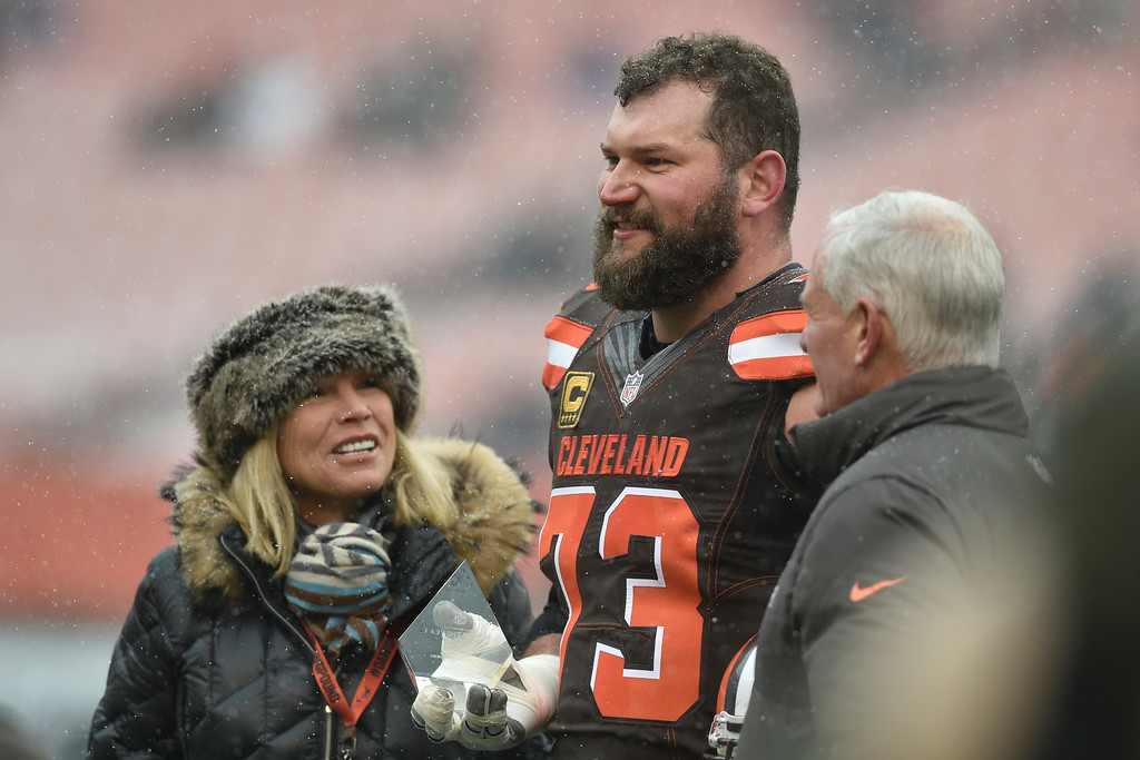 . Cleveland Browns tackle Joe Thomas, center, accepts the Cleveland Browns\' 2016 Walter Payton Man of the Year trophy before an NFL football game against the Cincinnati Bengals, Sunday, Dec. 11, 2016, in Cleveland. The Bengals won 23-10. (AP Photo/David Richard)