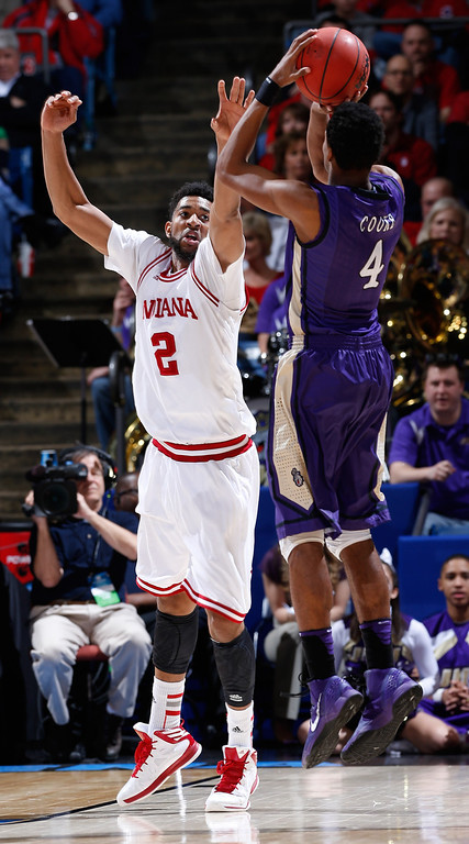 . DAYTON, OH - MARCH 22: Christian Watford #2 of the Indiana Hoosiers defends Charles Cooke #4 of the James Madison Dukes in the second half during the second round of the 2013 NCAA Men\'s Basketball Tournament at UD Arena on March 22, 2013 in Dayton, Ohio.  (Photo by Joe Robbins/Getty Images)