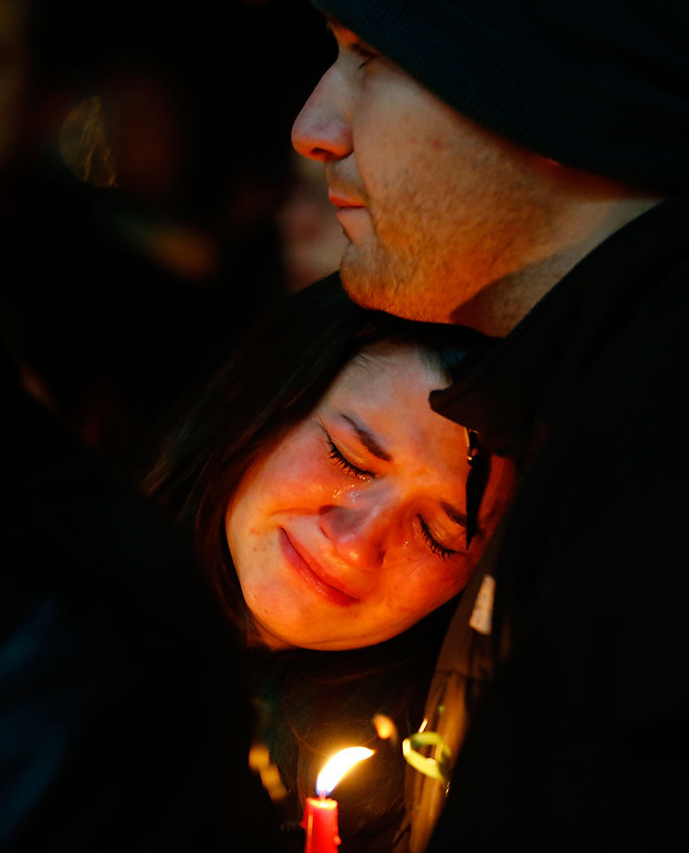. People mourn the loss of Victoria Soto, the first-grade teacher at Sandy Hook Elementary School who was shot and killed while protecting her students, during a candlelight vigil at Stratford High School on December 15, 2012 in Stratford, Connecticut. Twenty-six people were shot dead, including twenty children, after a gunman identified as Adam Lanza opened fire in the school. Lanza also reportedly had committed suicide at the scene. A 28th person, believed to be Nancy Lanza was found dead in a house in town, was also believed to have been shot by Adam Lanza. (Photo by Jared Wickerham/Getty Images)