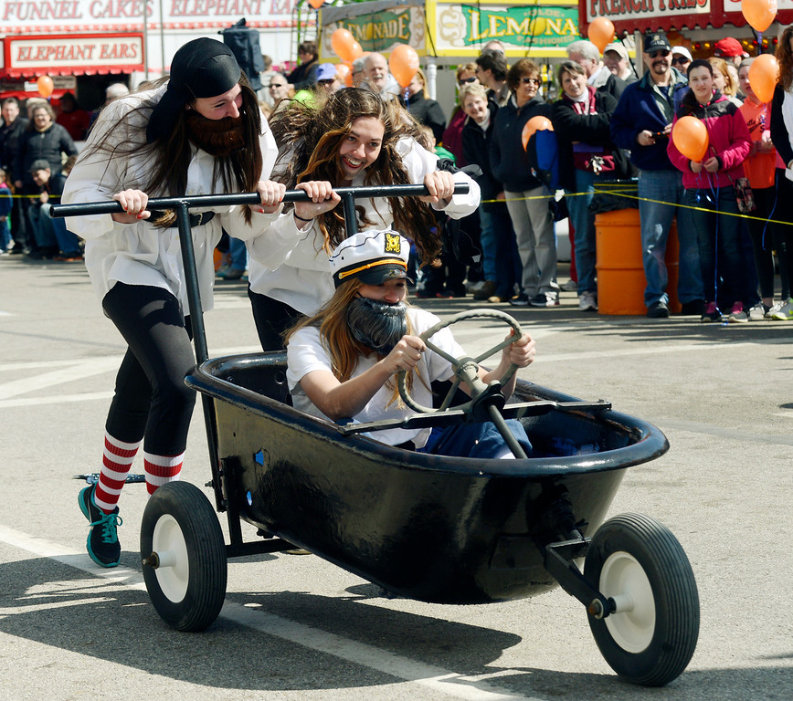 . Maribeth Joeright/MJoeright@News-Herald.com<p> Members of the Chardon fast-pitch team, Cassidy King, driving, Nicole Kreuz, left, and Rachel Tusick give it all they have during the popular bathrub races at the 85th annual Geauga County Maple Festival, April 27, 2014. The girls dressed as pirates for the occasion.