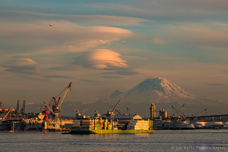 Amazing lenticular clouds over Mount Rainier, shot from the ferry approaching downtown Seattle just before sunset.