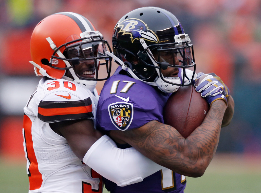 . Cleveland Browns defensive back Jason McCourty (30) tackles Baltimore Ravens wide receiver Mike Wallace (17) after a pass reception during the first half of an NFL football game, Sunday, Dec. 17, 2017, in Cleveland. (AP Photo/Ron Schwane)