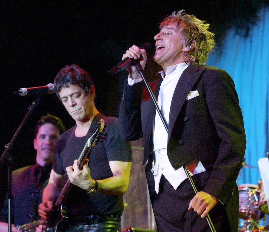 . Musicians Lou Reed and Rod Stewart perform on stage during Clive Davis\' pre-Grammy Gala at the Regency Hotel\'s Grand Ballroom February 22, 2003 in New York City.  (Photo by Frank Micelotta/Getty Images)