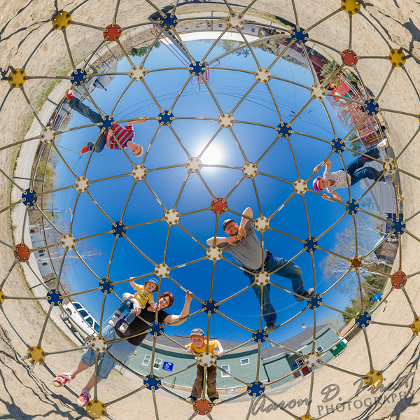 Family on playground geodome