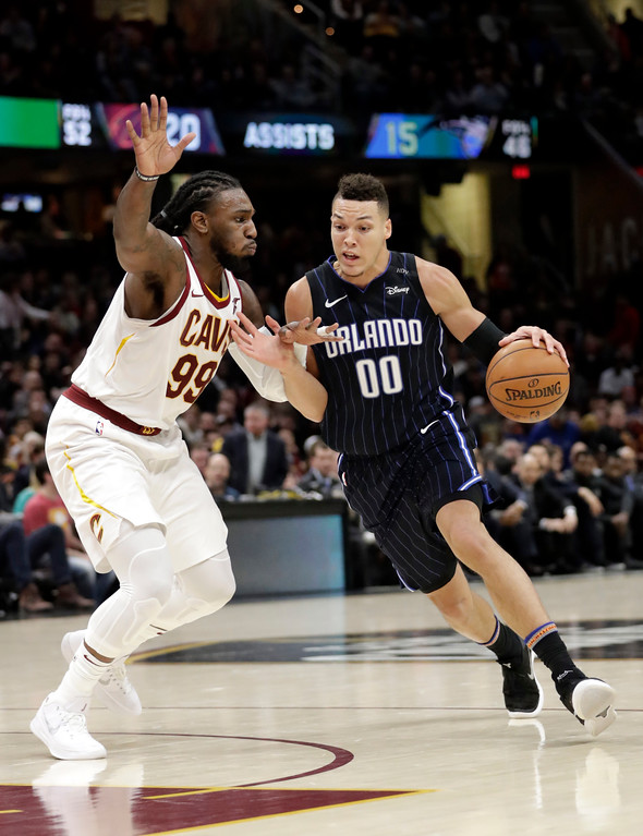 . Orlando Magic\'s Aaron Gordon (00) drives against Cleveland Cavaliers\' Jae Crowder (99) in the second half of an NBA basketball game, Thursday, Jan. 18, 2018, in Cleveland. (AP Photo/Tony Dejak)