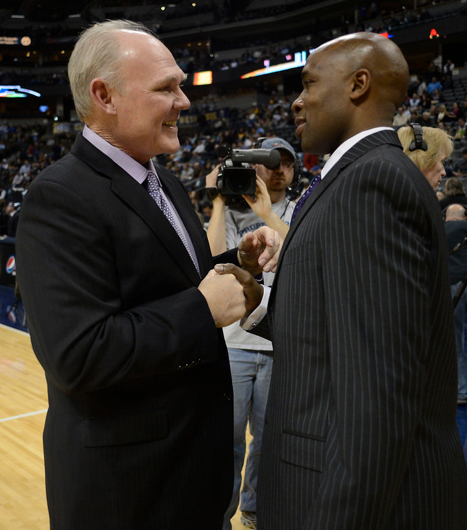 . Denver Nuggets head coach George Karl chats with Orlando Magic head coach Jacque Vaughn before their game Wednesday, January 9, 2013 at Pepsi Center. John Leyba, The Denver Post