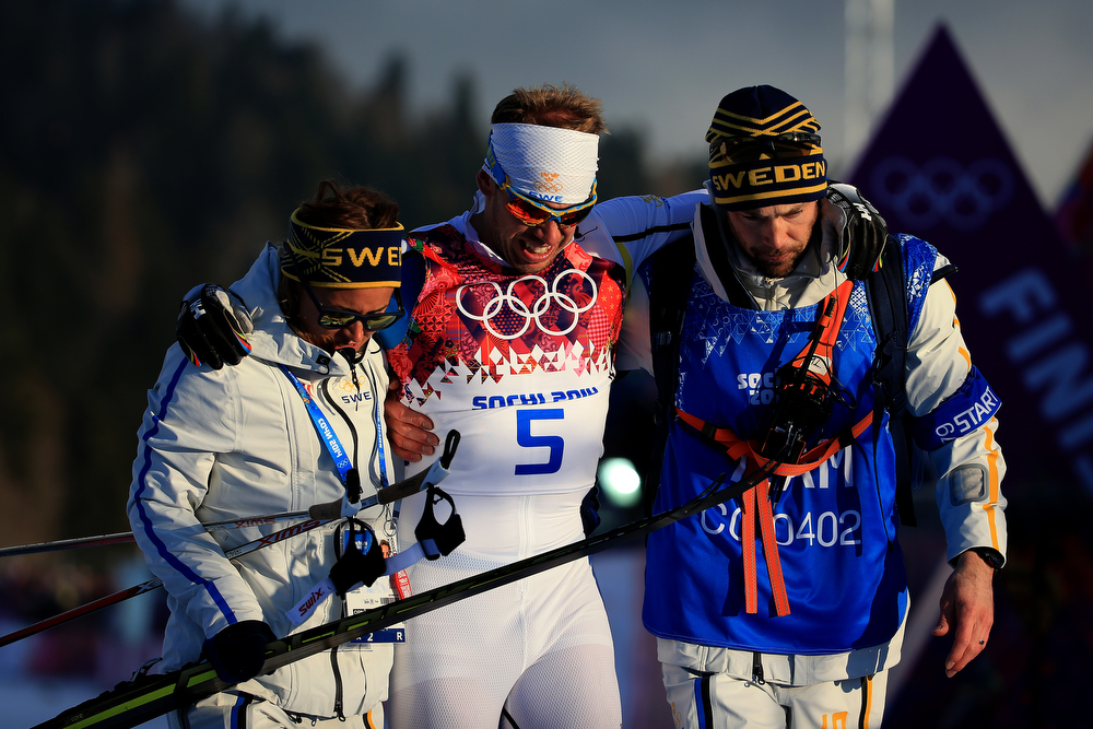 . SOCHI, RUSSIA - FEBRUARY 11:  Emil Joensson (C) of Sweden gets assistance in Finals of the Men\'s Sprint Free during day four of the Sochi 2014 Winter Olympics at Laura Cross-country Ski & Biathlon Center on February 11, 2014 in Sochi, Russia.  (Photo by Richard Heathcote/Getty Images)