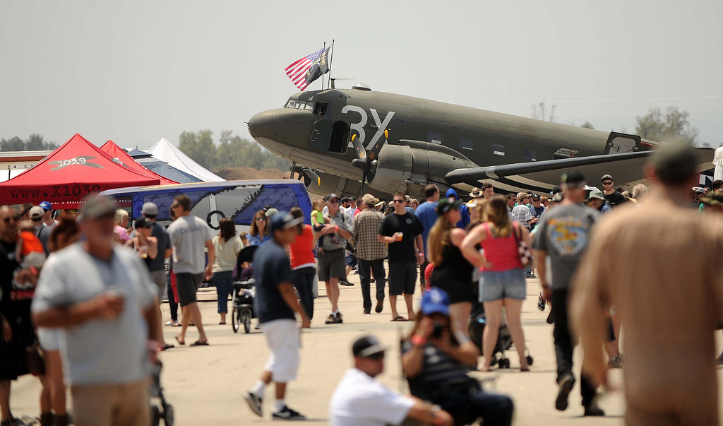 . Hangar 24 AirFest and 5th Anniversary Celebration was held on Saturday, May 18, 2013 at the Redlands Municipal Airport In Redlands. The event feature aerial acrobats, vintage warplanes, nighttime fireworks shot from aircraft, food trucks, a kids zone, live musical acts and 35 different beers, including special archival beers, all brewed by Hangar 24.LaFonzo Carter/ Staff Photographer