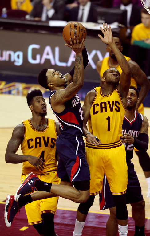 . Atlanta Hawks\' Kent Bazemore shoots over Cleveland Cavaliers\' James Jones (1) during the second half in Game 3 of the Eastern Conference finals of the NBA basketball playoffs Sunday, May 24, 2015, in Cleveland. (AP Photo/Ron Schwane)