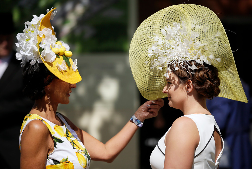 . Racegoers arrive for the third day of the Royal Ascot horse race meeting, which is traditionally known as Ladies Day, in Ascot, England Thursday, June 21, 2018. (AP Photo/Tim Ireland)