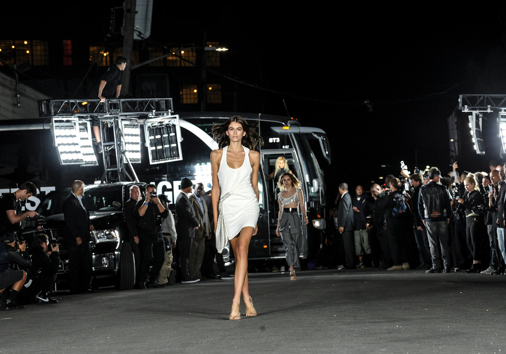 . Kaia Gerber models the first look at the Alexander Wang Spring 2018 fashion show held on a street in the Bushwick neighborhood of Brooklyn during New York Fashion Week, Saturday, Sept. 9, 2017. (AP Photo/Diane Bondareff)