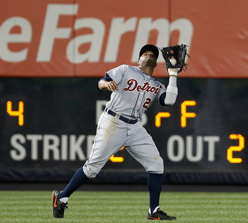 . Detroit Tigers  fielder Rajai Davis (20) fields a flyout in a baseball game against the New York Yankees at Yankee Stadium in New York, Wednesday, Aug. 6, 2014.  (AP Photo/Kathy Willens)