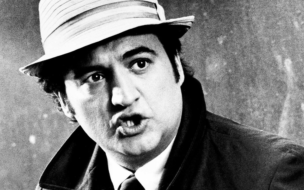 """. The late actor and comedian John Belushi, a first-generation \""""Saturday Night Live\"""" player, was born on this day in 1949. He died of a street-drug overdose in 1982, two years after his triumph \""""The Blues Brothers\"""" movie came out. He\'s shown portraying a Chicago newspaper reporter in his 1981 film \""""Continental Divide.\"""" (Associated Press photo)"""