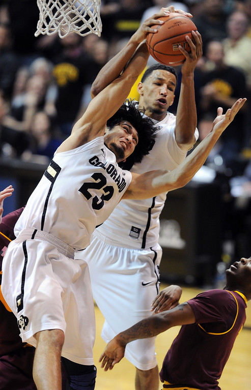 . Sabatino Chen and Andre Roberson battle on the boards against ASU during the second half of the February 16th, 2013 game in Boulder. Cliff Grassmick / February 16, 2013
