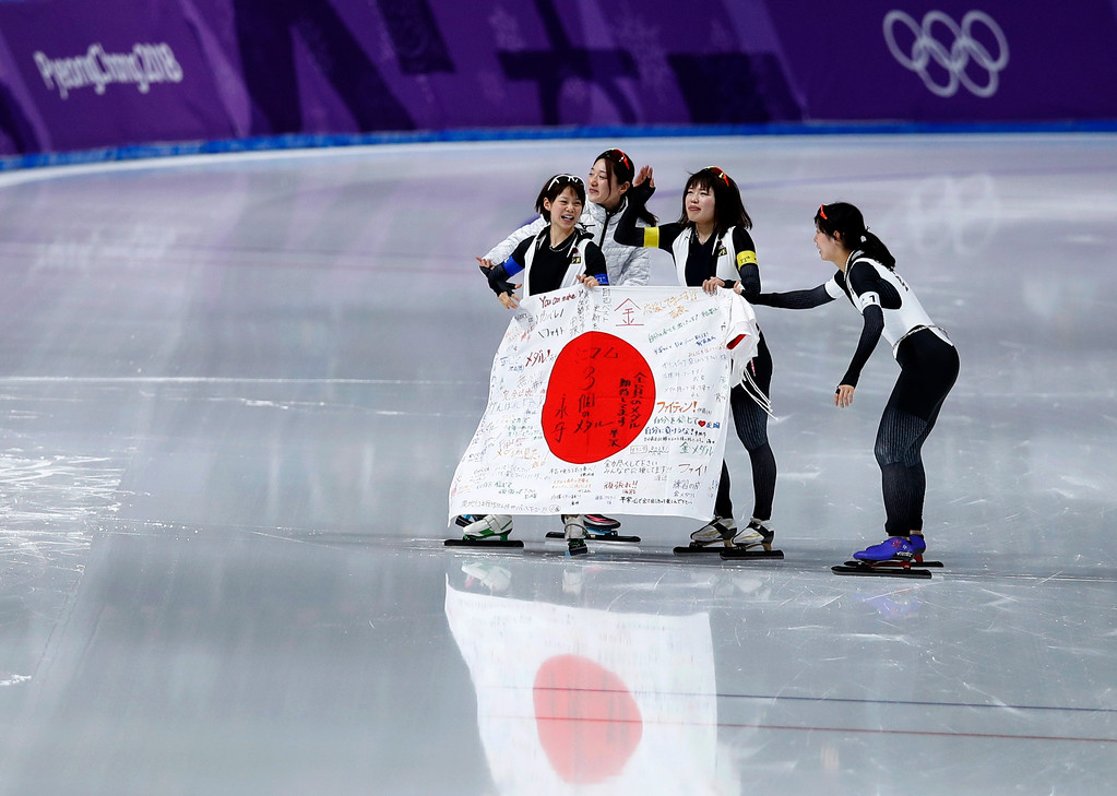 . Gold medalist Team Japan with Miho Takagi, right, Ayaka Kikuchi, rear waving, Ayano Sato, second right, and Nana Takagi, left, celebrates after the women\'s team pursuit final speedskating race at the Gangneung Oval at the 2018 Winter Olympics in Gangneung, South Korea, Wednesday, Feb. 21, 2018. (AP Photo/Vadim Ghirda)