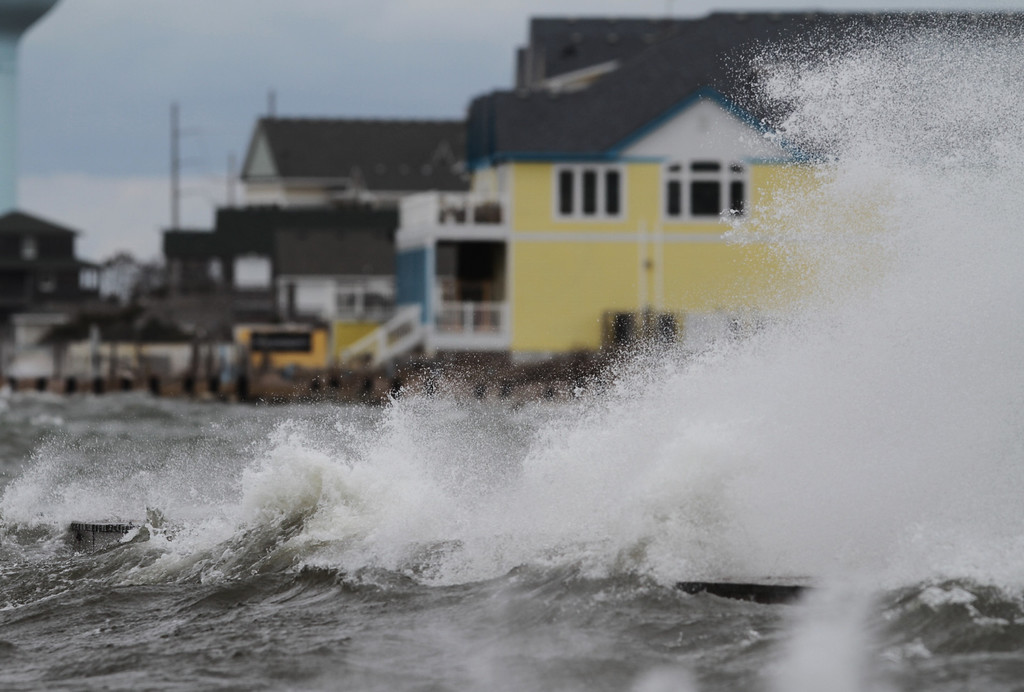. Strong west winds from the approaching winter storm push Pamlico Sound water up on Hatteras Island at Rodanthe, N.C.  on Wednesday, March 6, 2013.    After pummeling the nation\'s midsection with heavy snow, a late-winter storm made its way Wednesday to the East Coast, where residents braced for the possibility of power outages. (AP Photo/The Virginian-Pilot, Steve Earley)