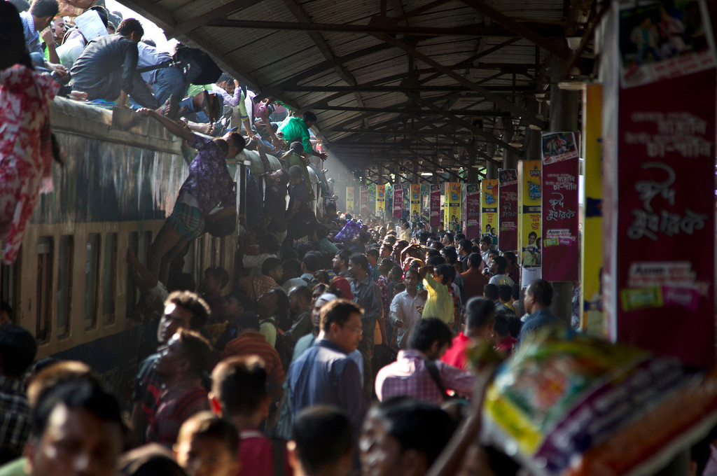 . Bangladeshi Muslims try to climb on to the roof of an overcrowded train as they head to their homes ahead of Eid al-Adha in Dhaka, Bangladesh, Friday, Oct. 3, 2014. Muslims around the world are preparing to celebrate Eid al-Adha, a three-day holiday that starts Saturday, commemorating the willingness of the prophet Ibrahim, or Abraham as he is known in the Bible, to sacrifice his son in accordance with God\'s will, though in the end God provides him a sheep to sacrifice instead. (AP Photo/A.M. Ahad)
