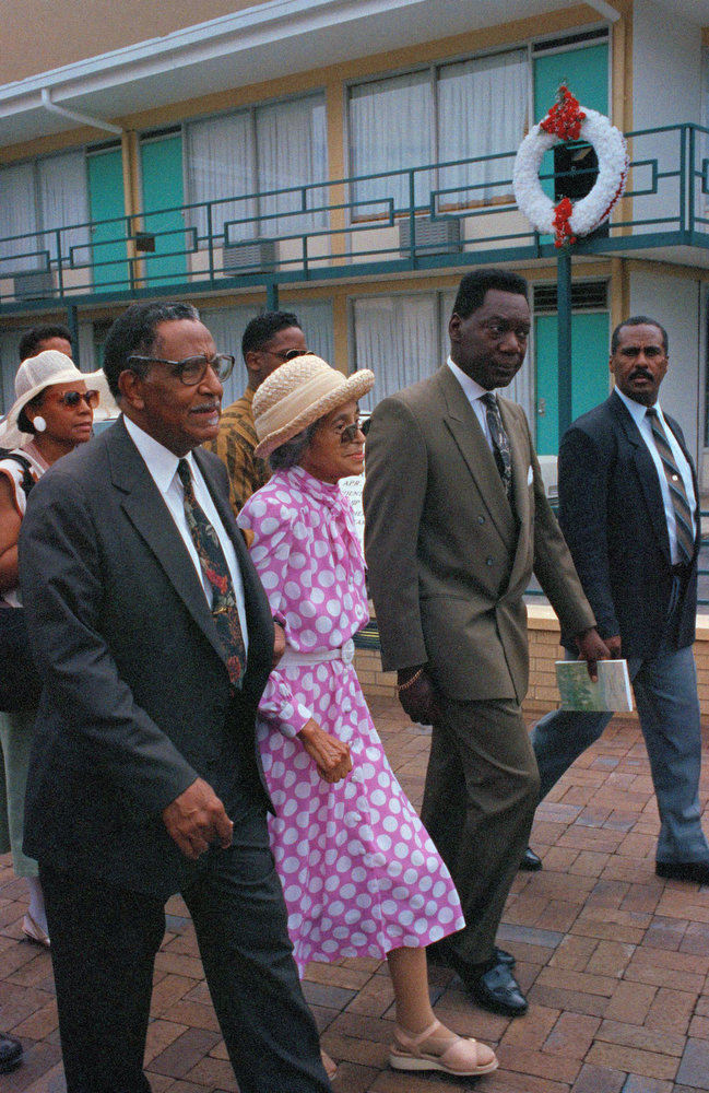 . Rosa Parks, whose refusal to give up her bus seat to a white man on Dec. 1, 1955 began a 381-day boycott of the Montgomery, Ala., city bus line, is escorted to the speaker\'s stand at the dedication of the National Civil Rights Museum on July 4, 1991 in Memphis. At upper right is a wreath marking the spot where Martin Luther King Jr. was killed. (AP Photo/Mark Humphrey)
