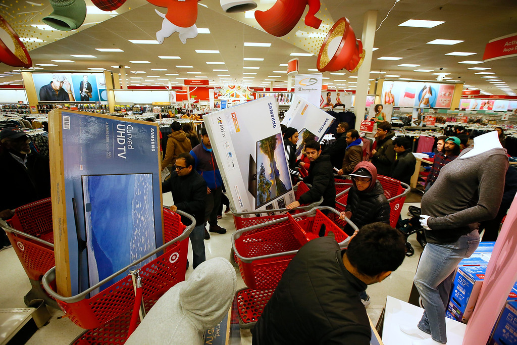 . IMAGE DISTRIBUTED FOR TARGET - Guests take advantage of Target\'s Black Friday electronics sales on Thursday, Nov. 24, 2016, in Jersey City, N.J. (Photo by Noah K. Murray/Invision for Target/AP Images)