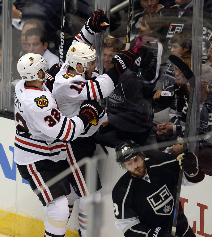. The Blackhawks� Jonathan Toews #19  and Michal Rozsival #32 celebrate a first period gaol by Toews  during Game 3 of the Western Conference finals against the Kings at the Staples Center on Saturday, May 24, 2014. (Photo by Hans Gutknecht/Los Angeles Daily News)